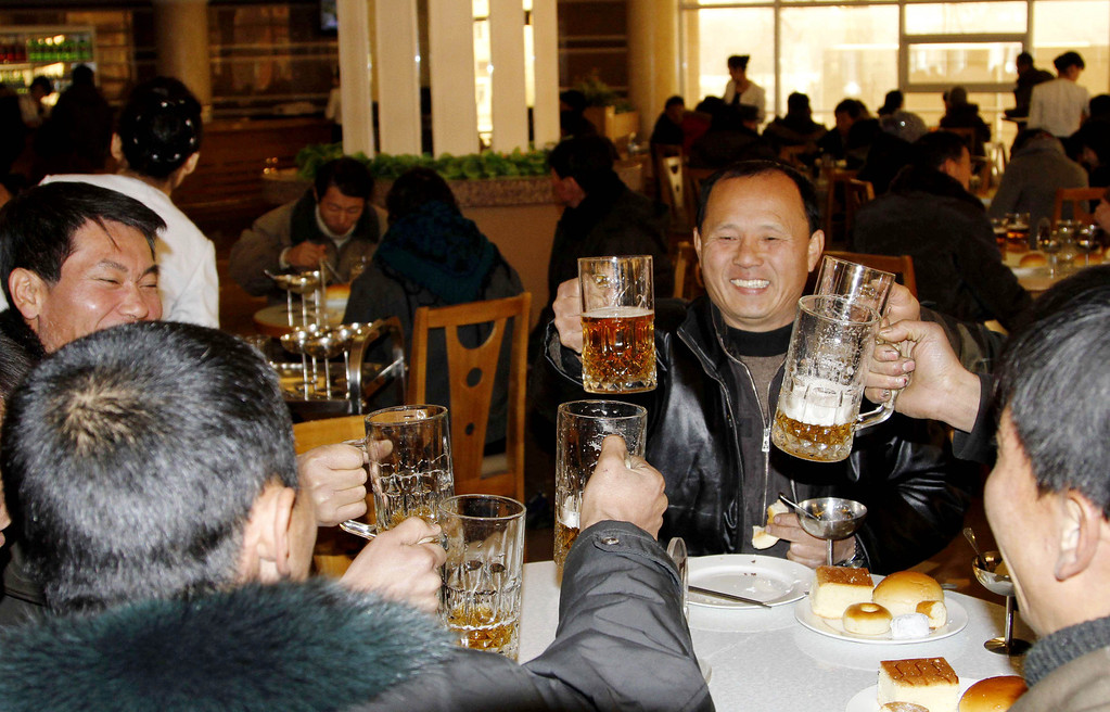 Description of . North Koreans toast after hearing the news of a  rocket launch with beer at the newly-built Mansukyo Restaurant on Wednesday, Dec. 12, 2012 in Pyongyang, North Korea. North Korea appeared to successfully fire a long-range rocket Wednesday, defying international warnings as the regime of Kim Jong Un pushes forward with its quest to develop the technology needed to deliver a nuclear warhead. (AP Photo/Kim Kwang Hyon)