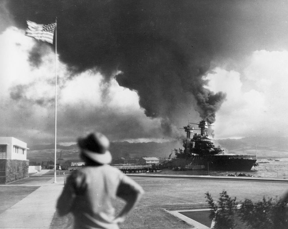 Description of . American ships burn during the Japanese attack on Pearl Harbor, Hawaii, in this Dec. 7, 1941 file photo.  (AP Photo, File)