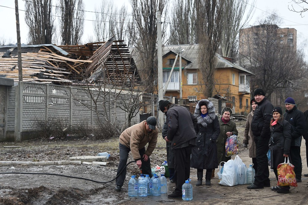 Description of . Residents fetch water from a well in Donetsk's Kiyevski district on February 5, 2015. Fourteen civilians and five government soldiers have been killed in fighting in east Ukraine over the past 24 hours, government and rebel officials said today. DOMINIQUE FAGET/AFP/Getty Images