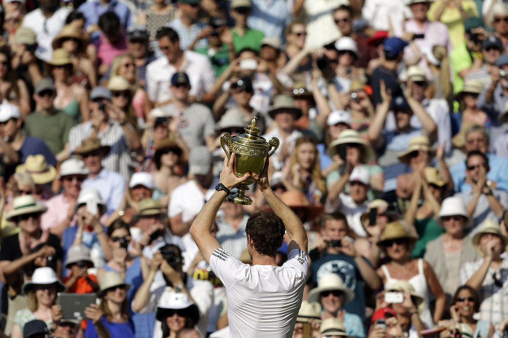 Description of . Britain's Andy Murray holds the winner's trophy during the presentation after beating Serbia's Novak Djokovic in the men's singles final on day thirteen of the 2013 Wimbledon Championships tennis tournament at the All England Club in Wimbledon, southwest London, on July 7, 2013. Murray won 6-4, 7-5, 6-4.  ANJA NIEDRINGHAUS/AFP/Getty Images