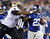 Stevie Brown #27 of the New York Giants is shoved out of bounds by Jermon Bushrod #74 of the New Orleans Saints on December 9, 2012 at MetLife Stadium in East Rutherford, New Jersey.  (Photo by Elsa/Getty Images)