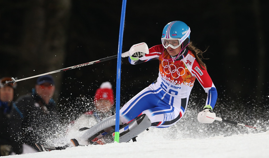 Description of . France's Anemone Marmottan skis in the second run of the women's slalom at the Sochi 2014 Winter Olympics, Friday, Feb. 21, 2014, in Krasnaya Polyana, Russia. (AP Photo/Luca Bruno)