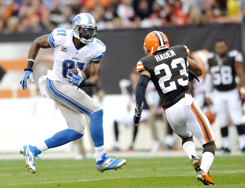 Description of . Detroit Lions wide receiver Calvin Johnson (81) makes a catch against Cleveland Browns cornerback Joe Haden (23) in the first quarter of an NFL football game Sunday, Oct. 13, 2013 in Cleveland. (AP Photo/David Richard)