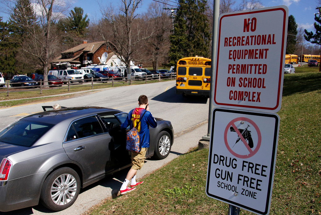 Description of . A student leave the campus of the Franklin Regional School District after more then a dozen students were stabbed by a knife wielding suspect at nearby Franklin Regional High School on Wednesday, April 9, 2014, in Murrysville, Pa., near Pittsburgh. The suspect, a male student, was taken into custody and is being questioned. (AP Photo/Gene J. Puskar)