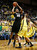 Colorado's Josh Scott puts up a shot in front of Oregon defenders Waverly Austin and Arsalan Kazemi, right,  during the first half of Colorado's game against Oregon in an NCAA college basketball game at Matthew Knight Arena in Eugene, Ore. Thursday, Feb. 7, 2013. (AP Photo/Brian Davies)