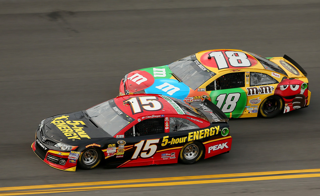 Description of . Clint Bowyer, driver of the #15 5-hour ENERGY Toyota, and Kyle Busch, driver of the #18 M&M\'s Toyota, race during the NASCAR Sprint Cup Series Budweiser Duel 2 at Daytona International Speedway on February 21, 2013 in Daytona Beach, Florida.  (Photo by Mike Ehrmann/Getty Images)