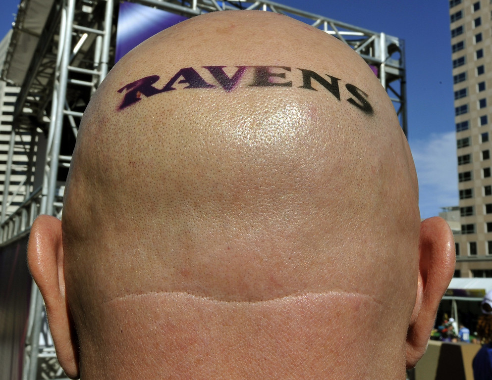 Description of . A Baltimore Ravens fan poses before the start of Super Bowl XLVII between the San Francisco 49ers and the Baltimore Ravens on February 3, 2013 at the Mercedes-Benz Superdome in New Orleans.    TIMOTHY A. CLARY/AFP/Getty Images