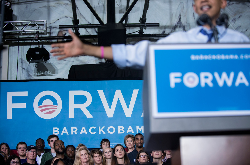 Description of . US President Barack Obama during a rally at Cornell College October 17, 2012 in Mt. Vernon, Iowa. Obama is traveling to Iowa and Ohio to attend campaign rallies in the two swing states.  (BRENDAN SMIALOWSKI/AFP/Getty Images)