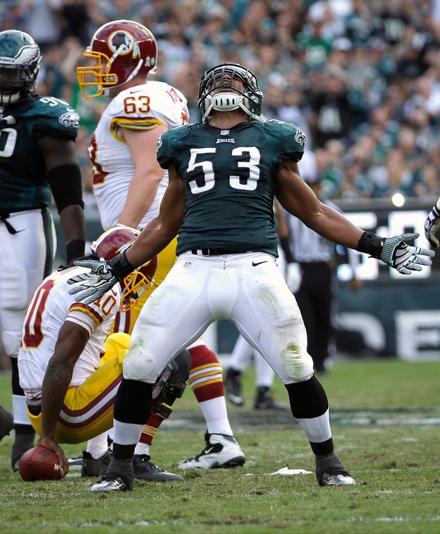 Description of . Philadelphia Eagles linebacker Najee Goode (53) celebrates his sack of Washington Redskins quarterback Robert Griffin III (10) during the first half of an NFL football game in Philadelphia, Sunday, Nov. 17, 2013. (AP Photo/Matt Slocum)