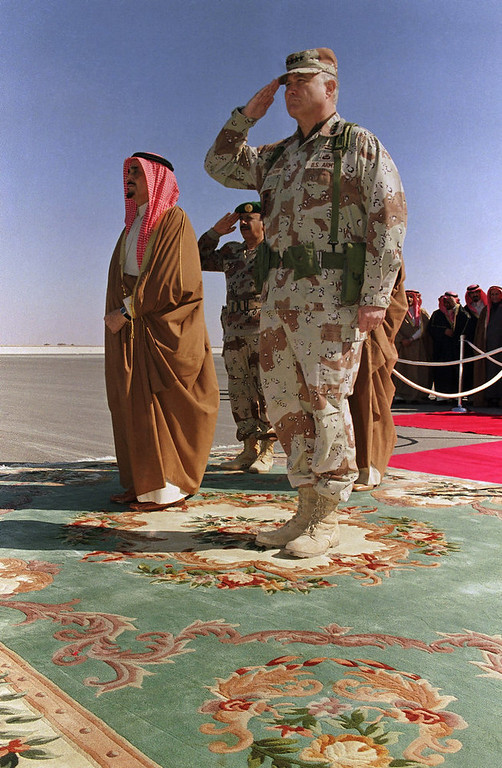 Description of . Saudi Arabian King Fahd, left, stands at attention with Gen. H. Norman Schwarzkopf, nicknamed ?The Bear,? commander of U.S. troops in the Gulf, during the king?s visit to review U.S. and allied troops in eastern Saudi Arabia on Sunday, Jan. 6, 1991. (AP Photo/Pool)