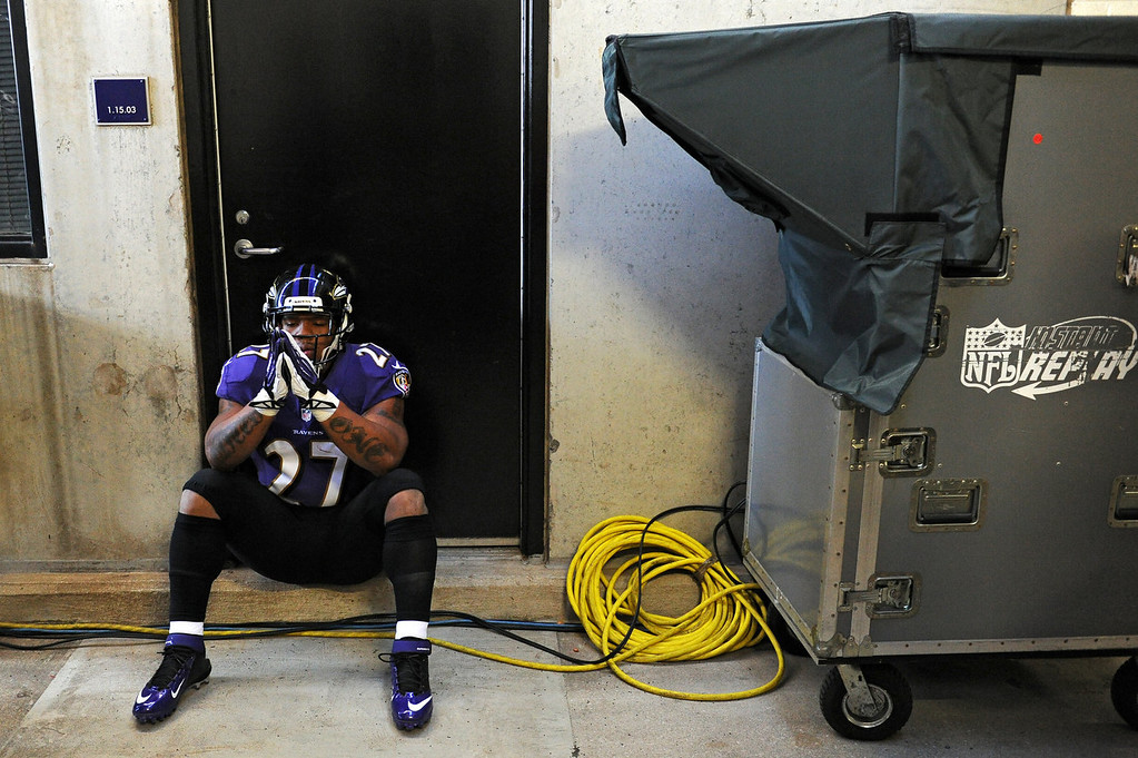 Description of . Running back Ray Rice #27 of the Baltimore Ravens has a moment to himself before playing the Cincinnati Bengals at M&T Bank Stadium on November 10, 2013 in Baltimore, Maryland. (Photo by Patrick Smith/Getty Images)
