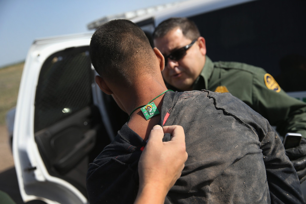 Description of . MISSION, TX - APRIL 11:  U.S. Border Patrol and U.S. Air and Marine agents detain an undocumented immigrant after chasing him down near the U.S.-Mexico border on April 11, 2013 near Mission, Texas. A group of 16 immigrants from Mexico and El Salvador said they crossed the Rio Grande River from Mexico into Texas during the morning hours before they were caught. The Rio Grande Valley sector of has seen more than a 50 percent increase in illegal immigrant crossings from last year, according to the Border Patrol. Agents say they have also seen an additional surge in immigrant traffic since immigration reform negotiations began this year in Washington D.C. Proposed refoms could provide a path to citizenship for many of the estimated 11 million undocumented workers living in the United States. Photo by John Moore/Getty Images)