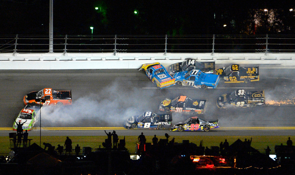 Description of . A wreck between Turns 3 and 4 ensnares Tim George Jr. (5), Jeff Agnew (27), Chris Fontaine (84), Brennan Newberry (14), German Quiroga (77), Brendan Gaughan (62), Jason White (93), Ryan Truex (30), Bryan Silas (99) and Max Gresham (8) during the NASCAR Truck Series auto race at Daytona International Speedway in Daytona Beach, Fla., Friday, Feb. 22, 2013. (AP Photo/Phelan M. Ebenhack)
