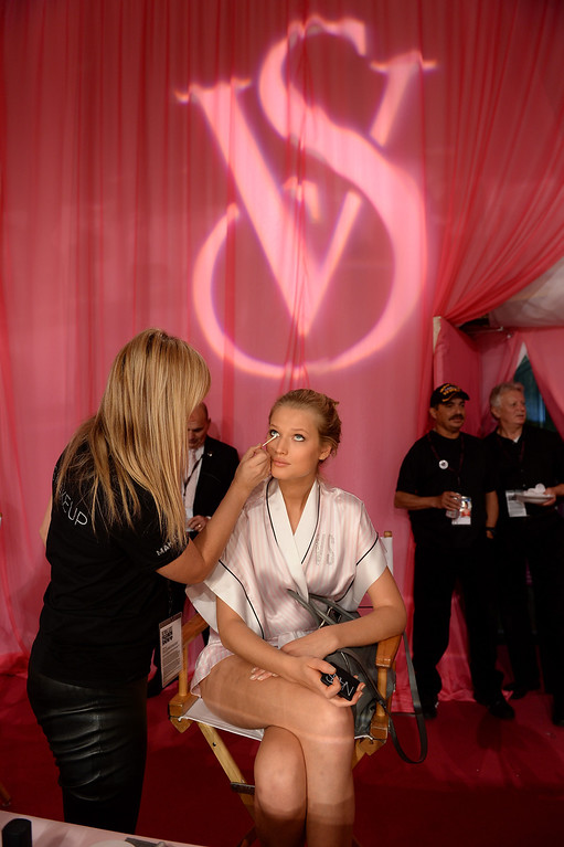 Description of . Model Toni Garrn prepares at the 2013 Victoria's Secret Fashion Show hair and make-up room at Lexington Avenue Armory on November 13, 2013 in New York City.  (Photo by Dimitrios Kambouris/Getty Images for Victoria's Secret)