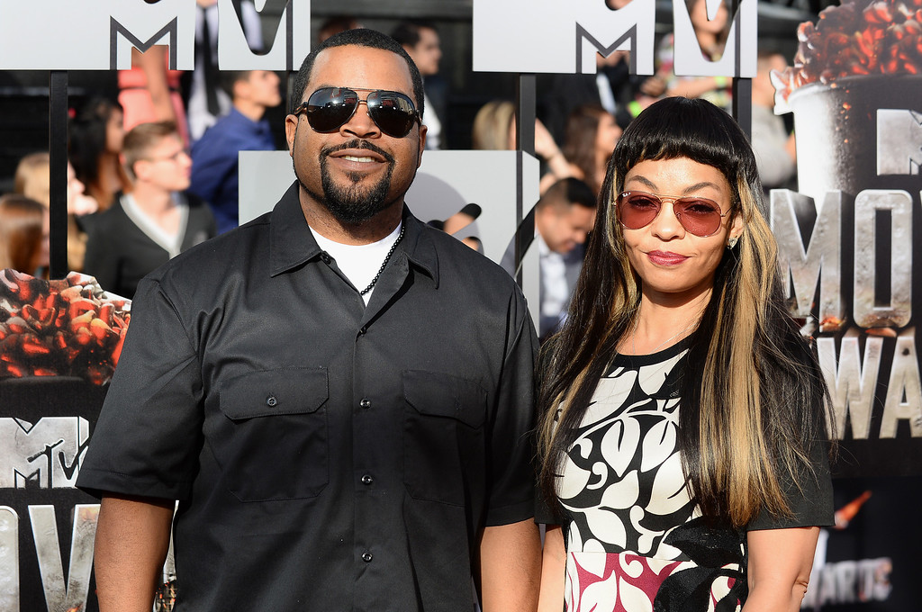 Description of . Ice Cube, left, and Kimberly Woodruff arrive at the MTV Movie Awards on Sunday, April 13, 2014, at Nokia Theatre in Los Angeles. (Photo by Jordan Strauss/Invision/AP)