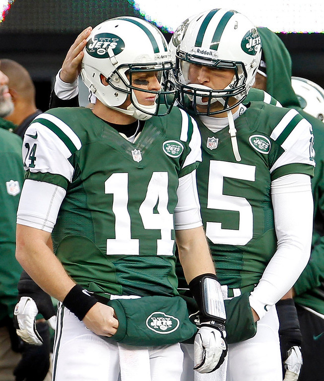. New York Jets quarterback Tim Tebow pats fellow quarterback Greg McElroy (L) on the head during the third quarter against the San Diego Chargers in their NFL football game in East Rutherford, New Jersey December 23, 2012.       REUTERS/Adam Hunger