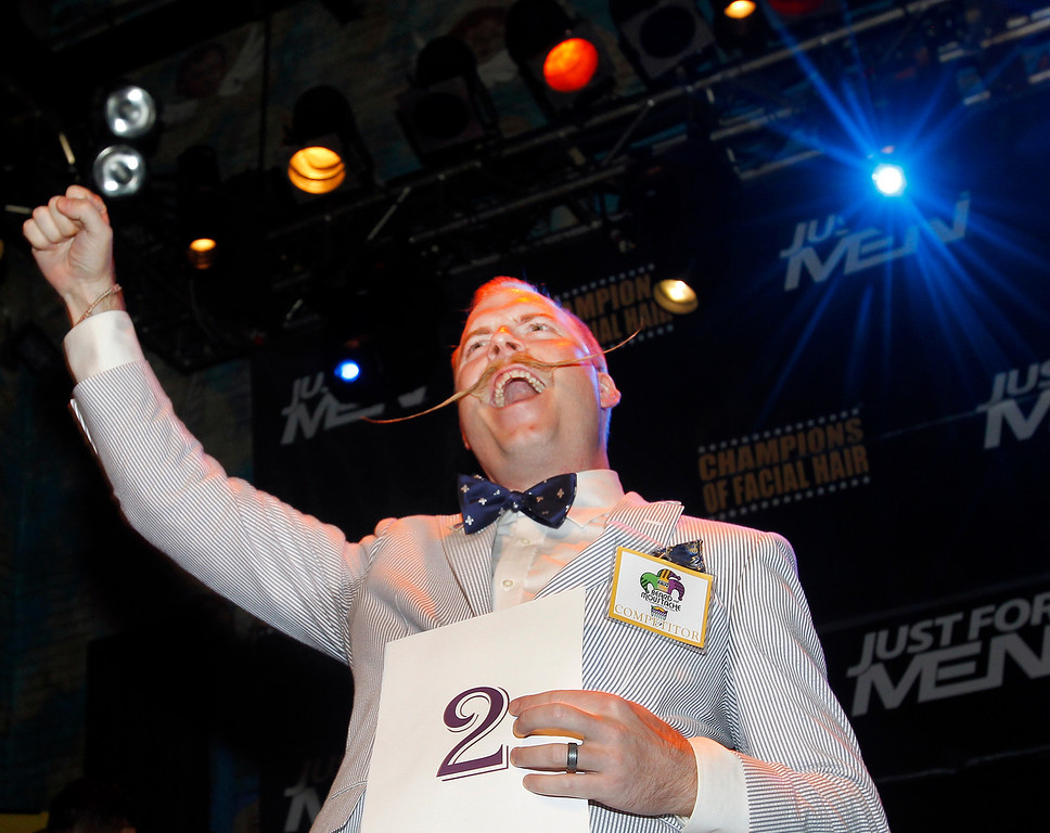 Description of . Nick Ackerman celebrates taking the gold for first place in the English Moustache division during the fourth annual Just For Men National Beard and Moustache Championships Saturday, Sept. 7, 2013 at The House of Blues in New Orleans. Contestants competed in 18 different categories including Dali, full beard natural and sideburns. (AP Photo/Susan Poag)