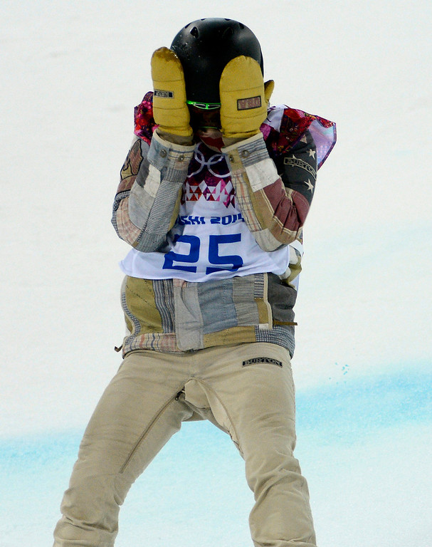 Description of . USA's Shaun White reacts to his first run during the finals for Men's Halfpipe at the Rosa Khutor Extreme Park for the 2014 Winter Olympics in Krasnaya Polyana, Russia on Tuesday, Feb. 11, 2014.  (Nhat V. Meyer/Bay Area News Group)