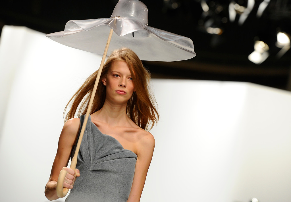 Description of . A model wears a creation for Chalayan's ready-to-wear Spring/Summer 2014 fashion collection, presented in Paris, Friday, Sept.27, 2013. (AP Photo/Zacharie Scheurer)