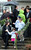 Children leave the Honan Funeral Home in Newtown on 12/17/2012 as others stand in line for funeral services for six-year-old Jack Pinto, a victim of the Sandy Hook Elementary School shootings.