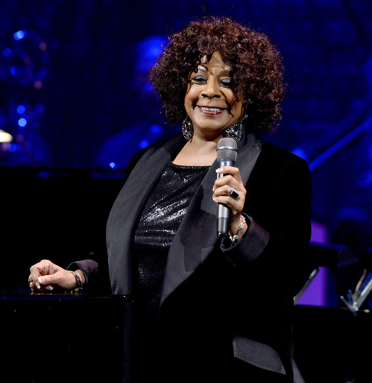 Description of . Singer Merry Clayton performs onstage during a celebration of Carole King and her music to benefit Paul Newman's The Painted Turtle Camp at the Dolby Theatre on December 4, 2012 in Hollywood, California.  (Photo by Michael Buckner/Getty Images for The Painted Turtle Camp)