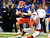 Florida Gators quarterback Jeff Driskel (L) is sacked by Louisville Cardinals defensive end Marcus Smith in the second quarter during their 2013 Allstate Sugar Bowl NCAA football game in New Orleans, Louisiana January 2, 2013.  REUTERS/Sean Gardner