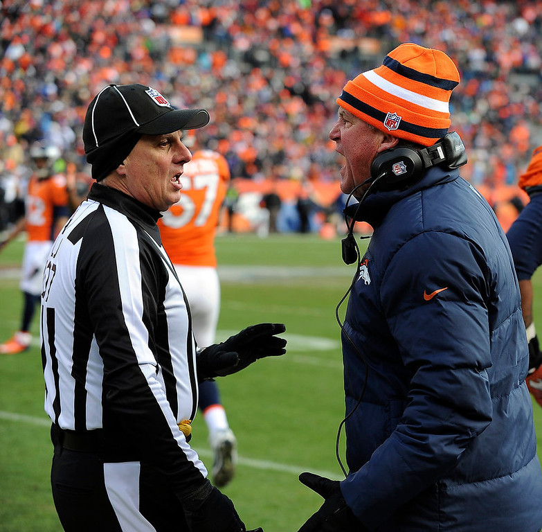 Description of . Denver Broncos head coach John Fox has words with Line Judge Ron Marinucci during the first half.  The Denver Broncos vs Baltimore Ravens AFC Divisional playoff game at Sports Authority Field Saturday January 12, 2013. (Photo by Tim Rasmussen,/The Denver Post)
