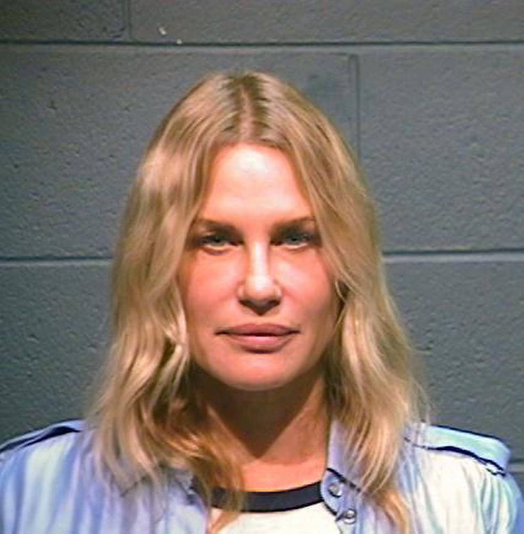 Description of . In this handout photo provided by the Wood County Sheriff's Department, actress Daryl Hannah is seen in a police booking photo October 4, 2012 in Quitman, Texas.  Hannah was arrested while protesting the Keystone XL oil pipeline October 4, 2012 in Winnsboro, Texas.  She was reportedly charged with criminal trespassing and resisting arrest.  Hannah was released on bond.  (Photo by Wood County Sheriff's Department via Getty Images)