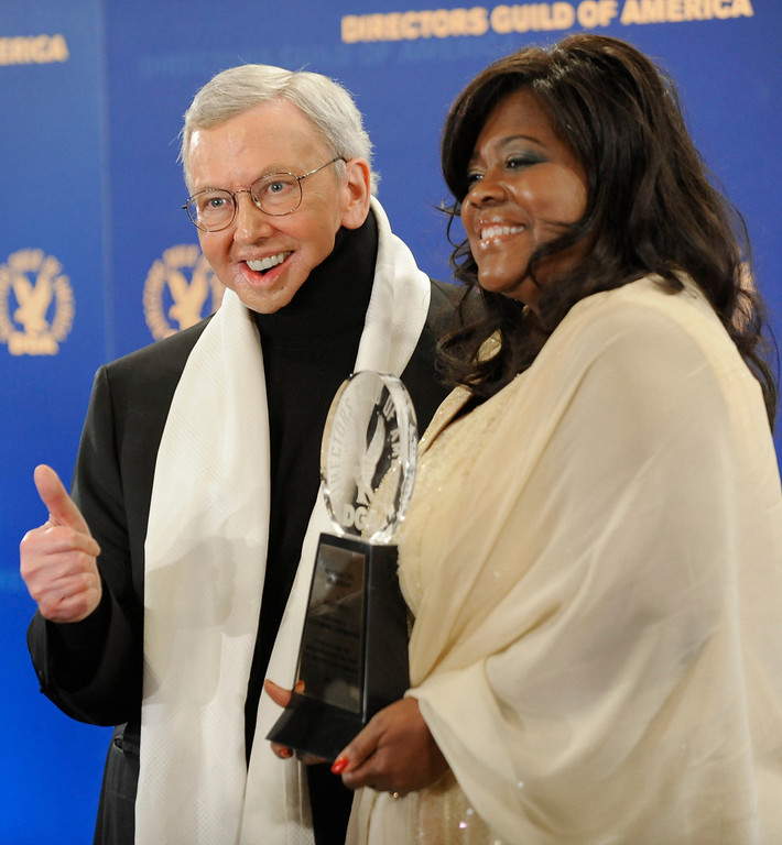 Description of . Film Critic and Author Roger Ebert, left, and wife Chaz pose with the Honorary Life Member Award backstage at the Directors Guild of America Awards on Saturday, Jan. 31, 2009, in Los Angeles.