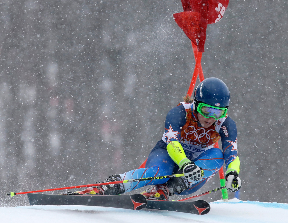 Description of . United States' Mikaela Shiffrin passes a gate in the second run of the women's giant slalom at the Sochi 2014 Winter Olympics, Tuesday, Feb. 18, 2014, in Krasnaya Polyana, Russia. (AP Photo/Luca Bruno)
