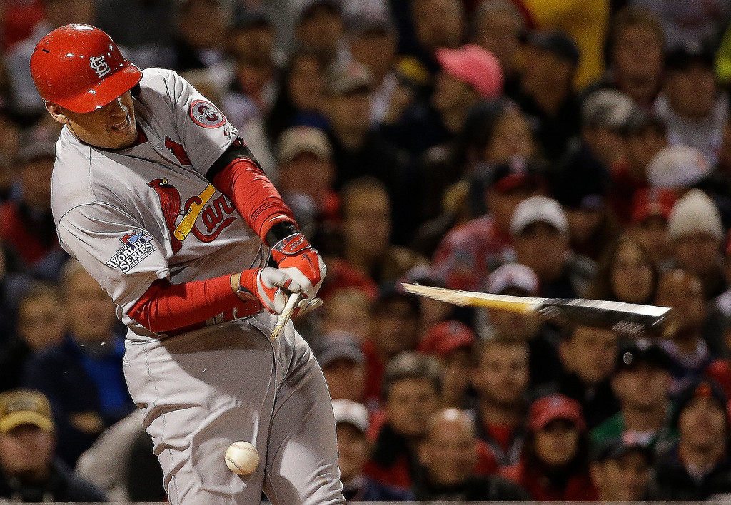 Description of . St. Louis Cardinals' Allen Craig breaks his bat as he fouls off a pitch during the fourth inning of Game 1 of baseball's World Series against the Boston Red Sox Wednesday, Oct. 23, 2013, in Boston. (AP Photo/David J. Phillip)