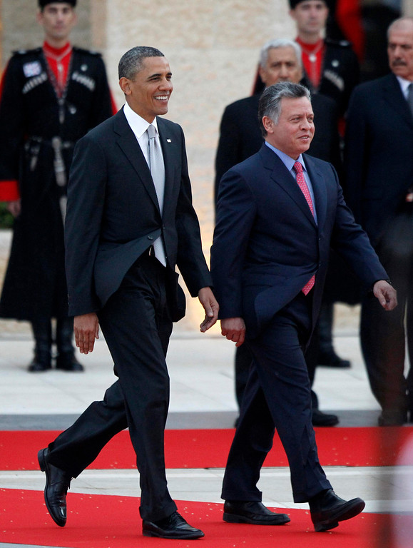 Description of . U.S. President Barack Obama (L) participates in an official arrival ceremony with Jordan's King Abdullah II at Al-Hummar Palace, in Amman March 22, 2013. REUTERS/Jason Reed