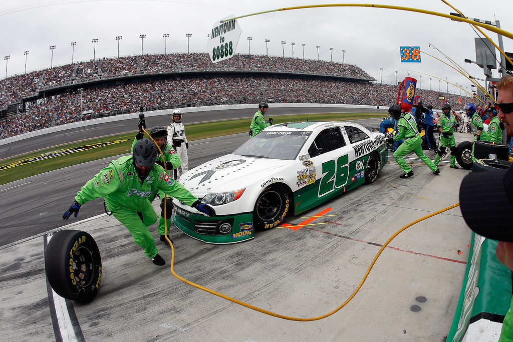 Description of . Michael Waltrip, driver of the #26 Sandy Hook School Support Fund Toyota, pits during the NASCAR Sprint Cup Series Daytona 500 at Daytona International Speedway on February 24, 2013 in Daytona Beach, Florida.  (Photo by Chris Graythen/Getty Images)