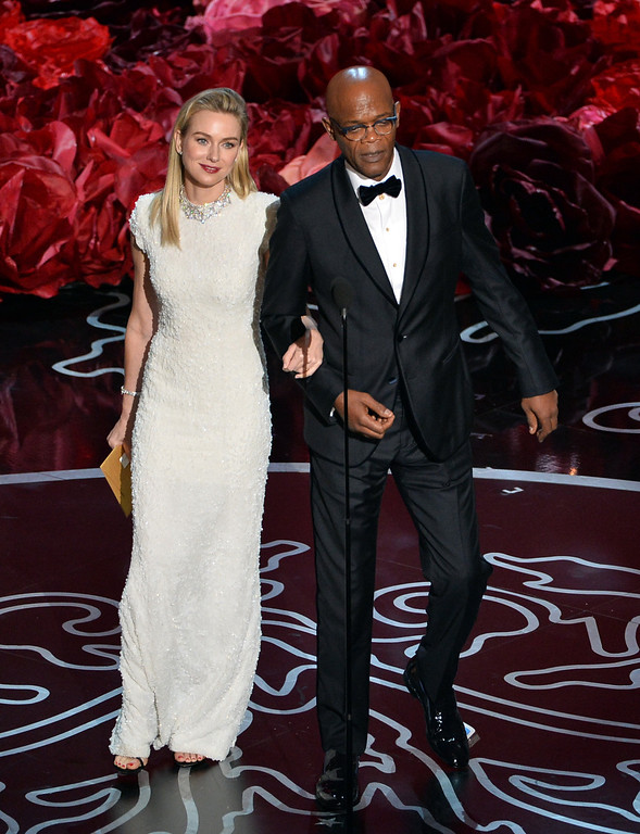 Description of . Actors Naomi Watts and Samuel L. Jackson speak onstage during the Oscars at the Dolby Theatre on March 2, 2014 in Hollywood, California.  (Photo by Kevin Winter/Getty Images)