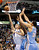 Dallas Mavericks forward Dirk Nowitzki (L) shoots against Denver Nuggets forward Kenneth Faried and center JaVale McGee (R) during the first half of their NBA basketball game in Dallas, Texas, December 28, 2012. REUTERS/Mike Stone (UNITED STATES - Tags: SPORT BASKETBALL)