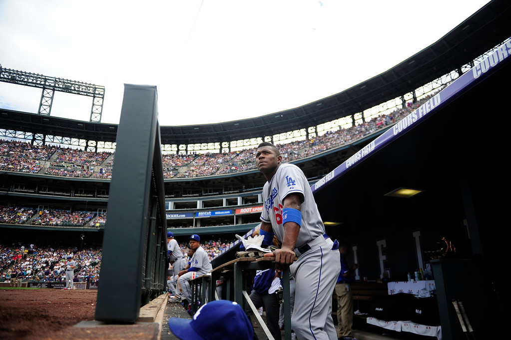 Description of . Yasiel Puig (66) of the Los Angeles Dodgers watches the action against the Colorado Rockies during the action in Denver on Monday, September 2, 2013. The Colorado Rockies hosted the Los Angeles Dodgers at Coors Field.   (Photo by AAron Ontiveroz/The Denver Post)