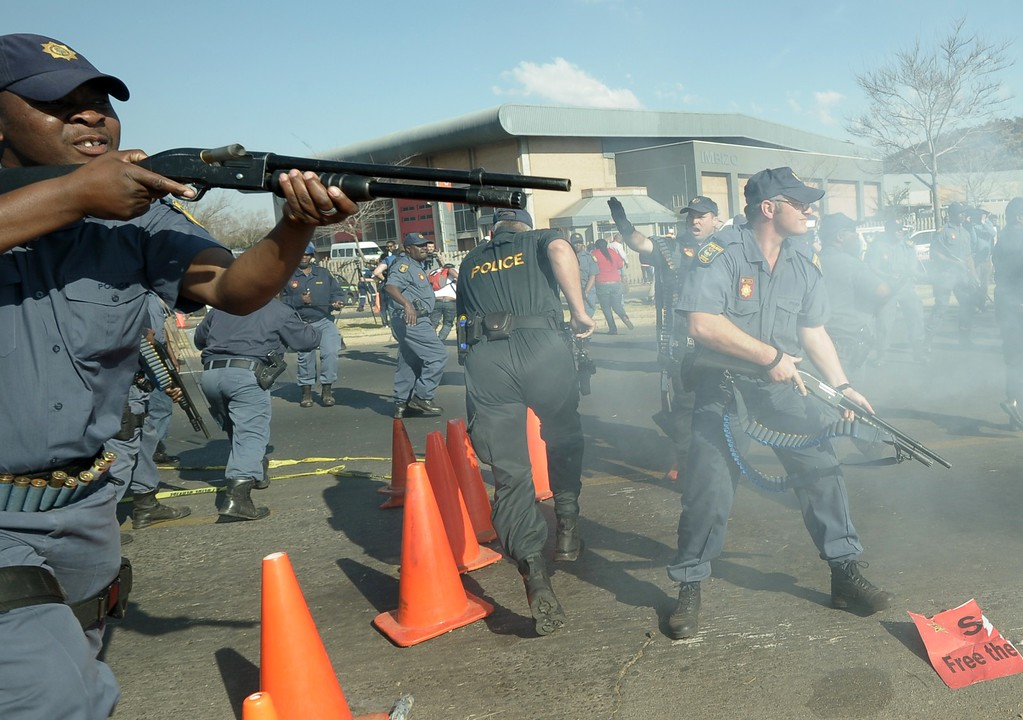 Description of . South African Police fire rubber bullets at protesters rallying against President Barack Obama's visit to South Africa, in Soweto on June 29, 2013. At least three bangs were heard as police tried to move the demonstrators away from a university campus where Obama is expected to hold a town hall event later in the day. ALEXANDER JOE/AFP/Getty Images