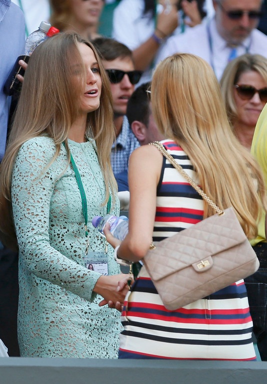 Description of . Kim Sears, the girlfriend of Andy Murray of Britain (L) shakes hands with Jelena Ristic, the girlfriend of Novak Djokovic of Serbia on Centre Court before the men's singles final tennis match between Murray and Djokovic at the Wimbledon Tennis Championships, in London July 7, 2013.  REUTERS/Stefan Wermuth