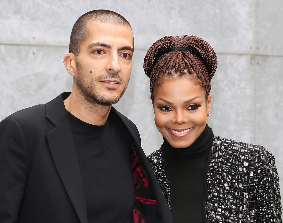 Description of . Wissam al Mana and Janet Jackson attend the Giorgio Armani fashion show during Milan Fashion Week Womenswear Fall/Winter 2013/14 on February 25, 2013 in Milan, Italy.  (Photo by Vittorio Zunino Celotto/Getty Images)