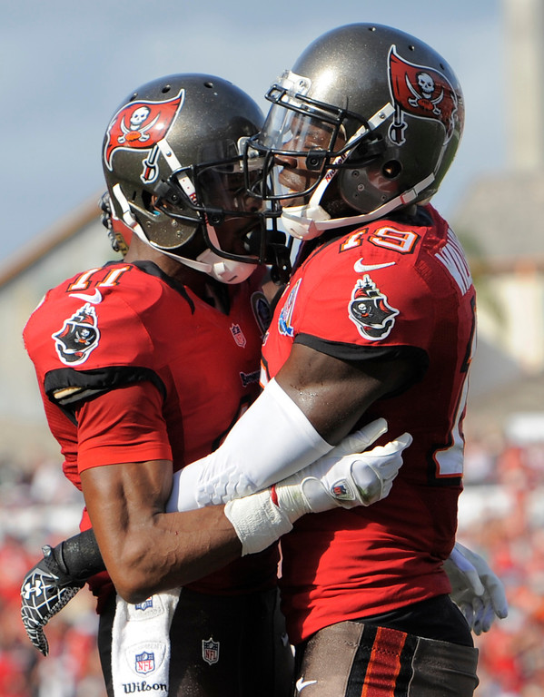 Description of . Tampa Bay Buccaneers wide receiver Mike Williams (19) celebrates with teammate wide receiver Tiquan Underwood after catching a one-yard touchdown pass against the Philadelphia Eagles during the third quarter of an NFL football game Sunday, Dec. 9, 2012, in Tampa, Fla. (AP Photo/Brian Blanco)