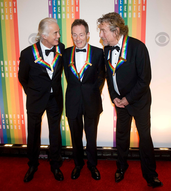 Description of . 2012 Kennedy Center Honorees and members of the band Led Zeppelin, from left, Jimmy Page, John Paul Jones, and Robert Plant chat on the red carpet after arriving at the Kennedy Center for the Performing Arts for the 2012 Kennedy Center Honors Performance and Gala Sunday, Dec. 2, 2012 at the State Department in Washington. (AP Photo/Kevin Wolf)
