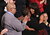 U.S. first lady Michelle Obama (R) hugs Cleopatra Cowley-Pendleton (C) and Nathaniel A. Pendleton Sr. (L) of Chicago, Illinois before U.S. President Barack Obama's State of the Union speech at the U.S. Capitol February 13, 2013 in Washington, DC. The Pendleton's daughter, Hadiya Pendleton, was murdered on January 29, 2013, when she was shot and killed in Harsh Park on Chicagos South Side.  (Photo by Chip Somodevilla/Getty Images)