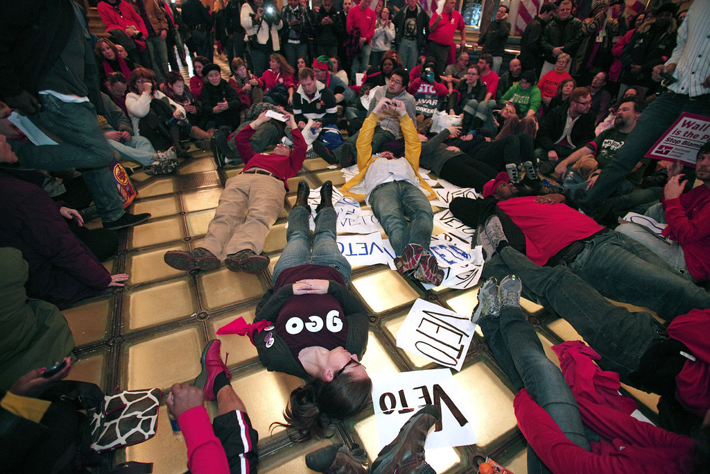 Description of . Union members hold a sit-in in the rotunda of the Michigan State Capitol to protest a vote on Right-to-Work legislation December 11, 2012 in Lansing, Michigan. Republicans control the Michigan House of Representatives, and Michigan Gov. Rick Snyder has said he will sign the bill if it is passed. The new law would make requiring financial support of a union as a condition of employment illegal. (Photo by Bill Pugliano/Getty Images)