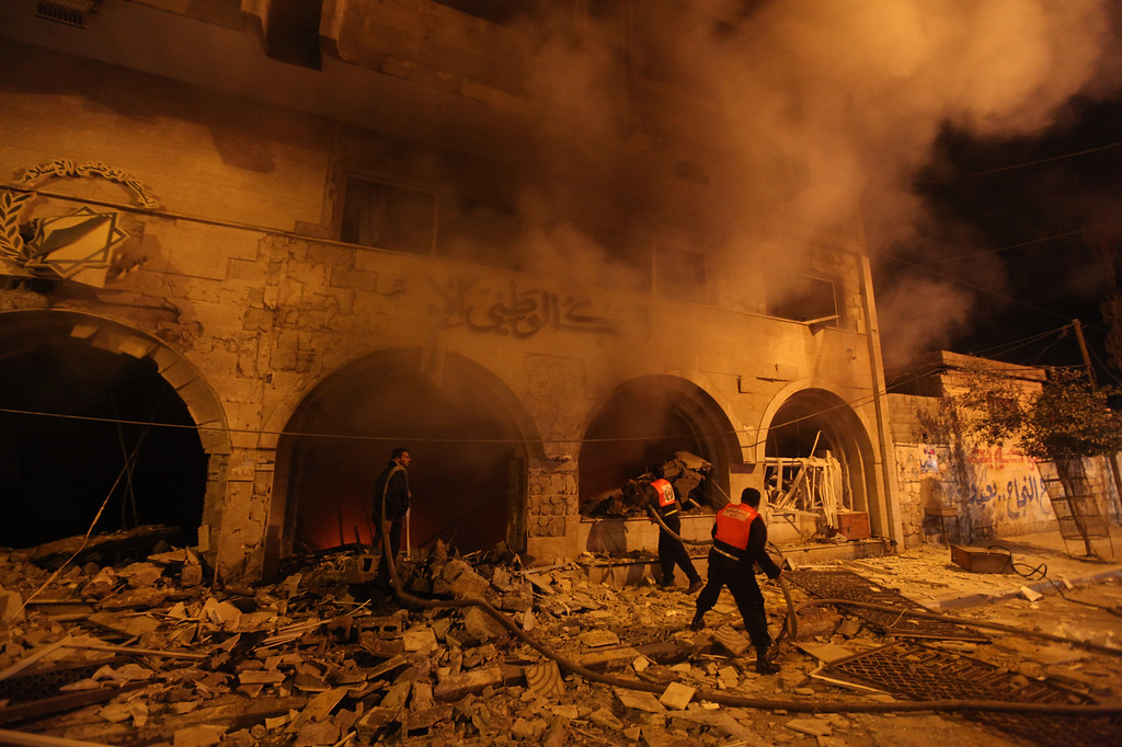 . Palestinian firefighters try to extinguish a blaze after an Israeli air strike on the Islamic National Bank building in Gaza City on November 20, 2012.  Israeli leaders discussed an Egyptian plan for a truce with Gaza\'s ruling Hamas, reports said, before a mission by the UN chief to Jerusalem and as the toll from Israeli raids on Gaza rose over 100.         (MAJDI FATHI/AFP/Getty Images)