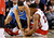 Toronto Raptors Rudy Gay fights for a loose ball against Denver Nuggets' Evan Fournier during the second half of their NBA basketball game in Toronto February 12, 2013.  REUTERS/Jon Blacker