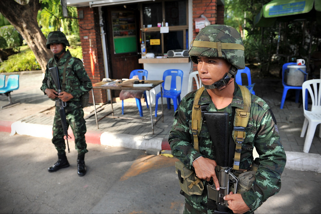 Description of . Thai army soldiers stand guard outside the National Broadcasting Services of Thailand after martial law was declared on May 20, 2014 in Bangkok, Thailand.  (Photo by Rufus Cox/Getty Images)