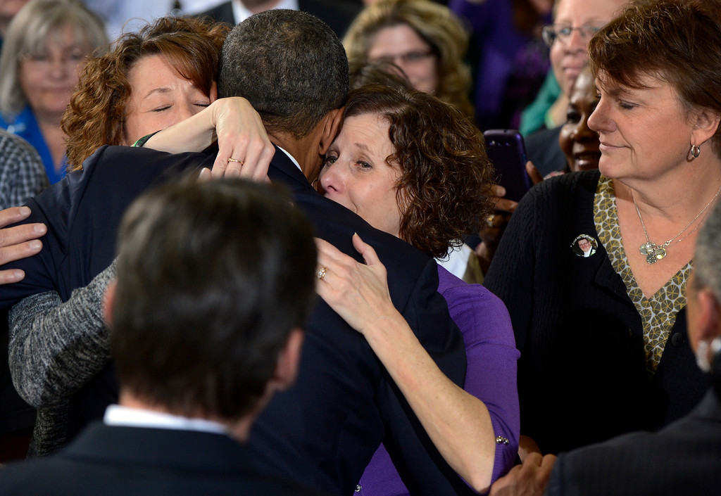 Description of . DENVER, CO. - APRIL 03: President Barack Obama embraces Siblings (l-r) Sue Connors and Jane Dougherty following a forum at the Denver Police Academy in Denver, CO April 03, 2013. The siblings sister, Mary Sherlach, was killed at  Sandy Hook Elementary. In his first trip to Colorado since his re-election, President Obama urged Congress to act more like the state's Democratic-controlled legislature and quickly pass stronger gun-control laws. During the meeting with law enforcement officials and community leaders, Obama praised lawmakers and Gov. John Hickenlooper for passing some of the nation's strongest gun-control measures after the shootings in Aurora and at a Connecticut elementary school. (Photo By Craig F. Walker/The Denver Post)