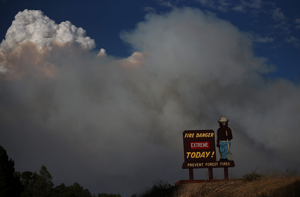 Description of . GROVELAND, CA - AUGUST 21:  A Smokey the Bear sigb is posted along US highway 120 as the Rim Fire burns out of control on August 21, 2013 in Groveland, California. The Rim Fire continues to burn out of control and threatens 2,500 homes outside of Yosemite National Park. Over 400 firefighters are battling the blaze that is only 5 percent contained.  (Photo by Justin Sullivan/Getty Images)
