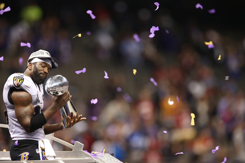 Description of . Ed Reed #20 of the Baltimore Ravens celebrates with the Vince Lombardi trophy after the Ravens won 34-31 against the San Francisco 49ers during Super Bowl XLVII at the Mercedes-Benz Superdome on February 3, 2013 in New Orleans, Louisiana.  (Photo by Ronald Martinez/Getty Images)