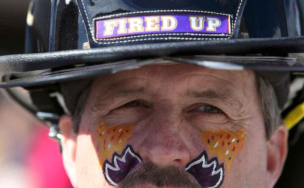 Description of . A Baltimore Ravens fan stands outside the Superdome before the NFL Super Bowl XLVII football game against the San Francisco 49ers in New Orleans, Louisiana, February 3, 2013. REUTERS/Sean Gardner